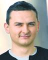 Łukasz Guza dziennikarz DGP