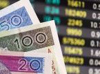 Mocny dolar i spadki na Wall Street ciążą złotemu